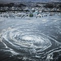 a_small_boat_gets_stuck_in_a_tsunami_whirlpool