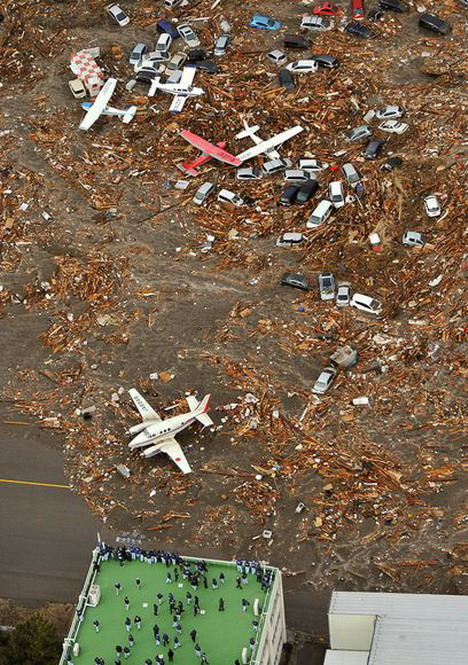 tsunami_hits_airport_in_sendai_japan